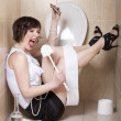 Stock Photo: Drunk womsitting dizzy on toilet floor