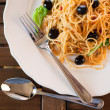 Spaghetti with black olives — Stock Photo