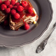 Stock Photo: Chocholate raspberry pancake dessert on table cover.