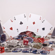 Outstretched cards with chips - Stock Photo
