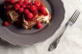 Chocholate raspberry pancake dessert on an table cover. — Stock Photo