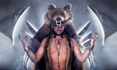Scary man in a bear coat with scar — Stock Photo