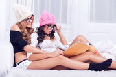 Two sexy girls reading — Stock Photo