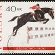 Horse jumping postage stamp — Stock Photo