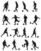 Fotboll spelare silhuetter — Stockvektor