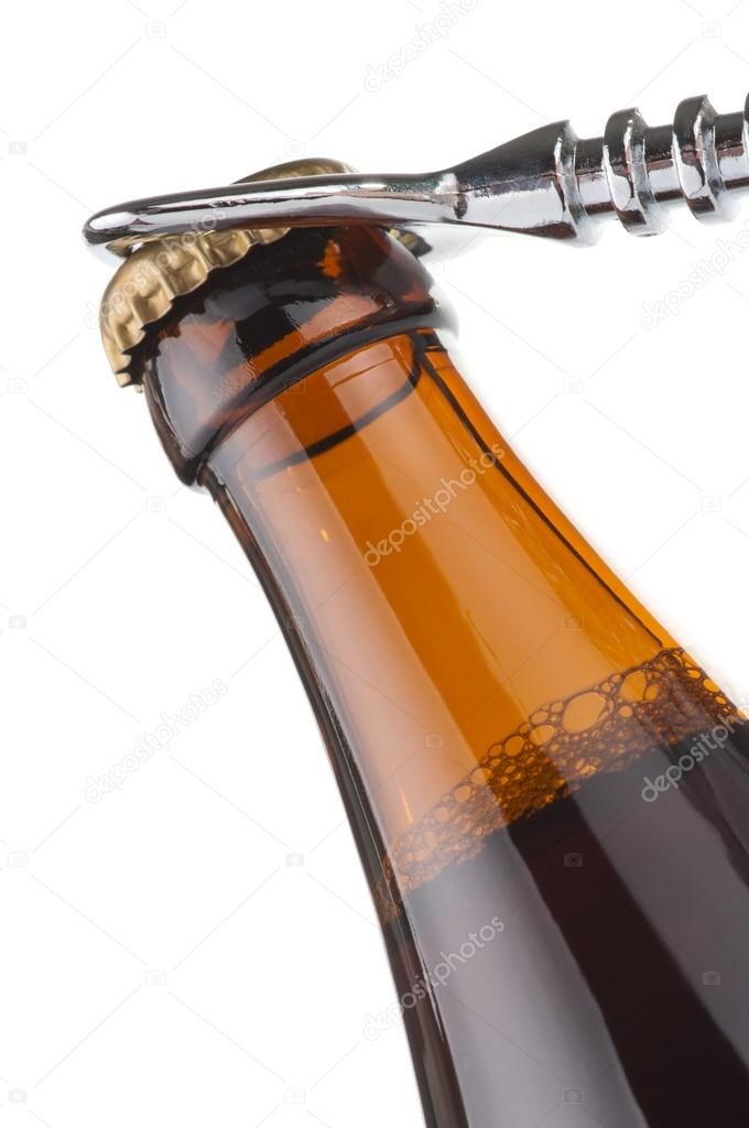 Opening dark beer bottle with metal opener  Stock Photo #12132899