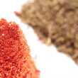 Stock Photo: Piles of paprika and aromatic herb