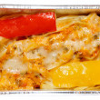 Cooked pasta with bell pepper in foil tray — Stock Photo