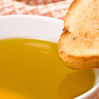 Stock Photo: Piece of bread and olive oil