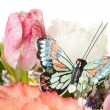 Stock Photo: Natural flowers with artificial butterfly