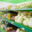 Shelf with groceries in supermarket — Stock Photo #12472277