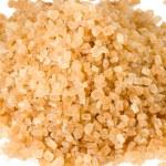 Heap of brown cane sugar, macro lens shot — Stock Photo