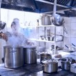 Stock Photo: Chef cooking at commercial kitchen