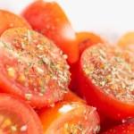 Fresh cherry tomatoes with aromatic herbs — Stock Photo