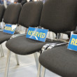 Reserved chairs in conference hall — Stock Photo