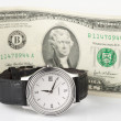 Time and money - hand watch with 2-dollar bill — Foto de Stock