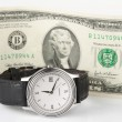 Time and money - hand watch with 2-dollar bill — Stock fotografie