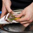 Chef is cooking dorade — Stock Photo