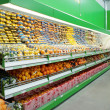 Shelf with citrus fruits in supermarket — Stockfoto