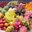 Various trropical fruits on market stall — Stock fotografie
