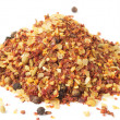 Heap of hot seasoning, macro shot, isolated — Stock Photo