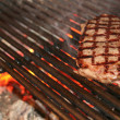 Ribeye steak on grille — Stock Photo