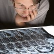 Worried man looking at his MRI — Stock Photo