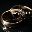 Two golden rings with sapphire and diamonds, slightly toned — Stock Photo