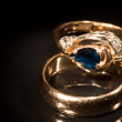 Two golden rings with sapphire and diamonds — Stock Photo