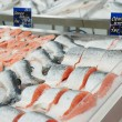 Salmon on cooled market display — Stock Photo