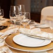 Place setting in restaurant — Stock Photo #12475697
