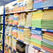Big shelf with textiles — Stock Photo
