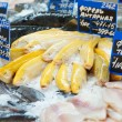 图库照片: Yellow trout on fish market display