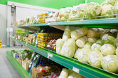 Shelf with groceries in supermarket — Stock Photo