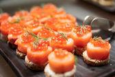 Salmon canapes — Stock Photo