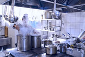 Chef cooking at commercial kitchen — Stock Photo