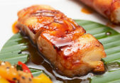 Fried black cod with soy sauce — Stock Photo
