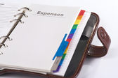 "Open personal organizer with copy ""expenses"", close-up — Stock Photo"