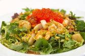 Seafood salad with salmon caviar — Stock Photo