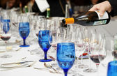 Pouring wine - winetasting event — Stock Photo