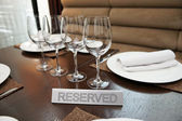 Reserved plate on an arranged table — Stock Photo