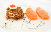 Salmon fillet with bread and caviar — Stock Photo
