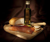 Salmon, bread and olive oil — Stock Photo