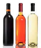 Three bottles with red, pink and white wines — Stock Photo