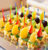 Canapes of cheese with fruits — Stock Photo