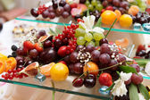 Fruits on banquet table — Stock Photo