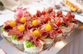 Canapes with cured ham — Fotografia Stock