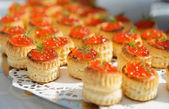 Tartlets with salmon caviar — Stock Photo