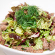 Fresh salad with duck liver and lettuce - Stock Photo
