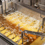 Deep fryer with oil on restaurant kitchen — Stock Photo #12813170